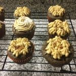 chocolate cupcakes peanut butter butter cream on cooling rack